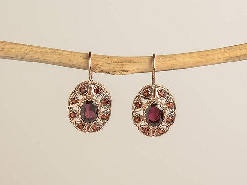 Oval Shaped Drop Earrings with Garnet Stones