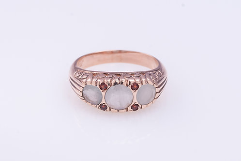 Milky Aquamarine Row and Garnet Ring