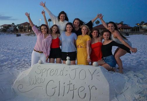 Spread Joy like Glitter Sand Sculpture