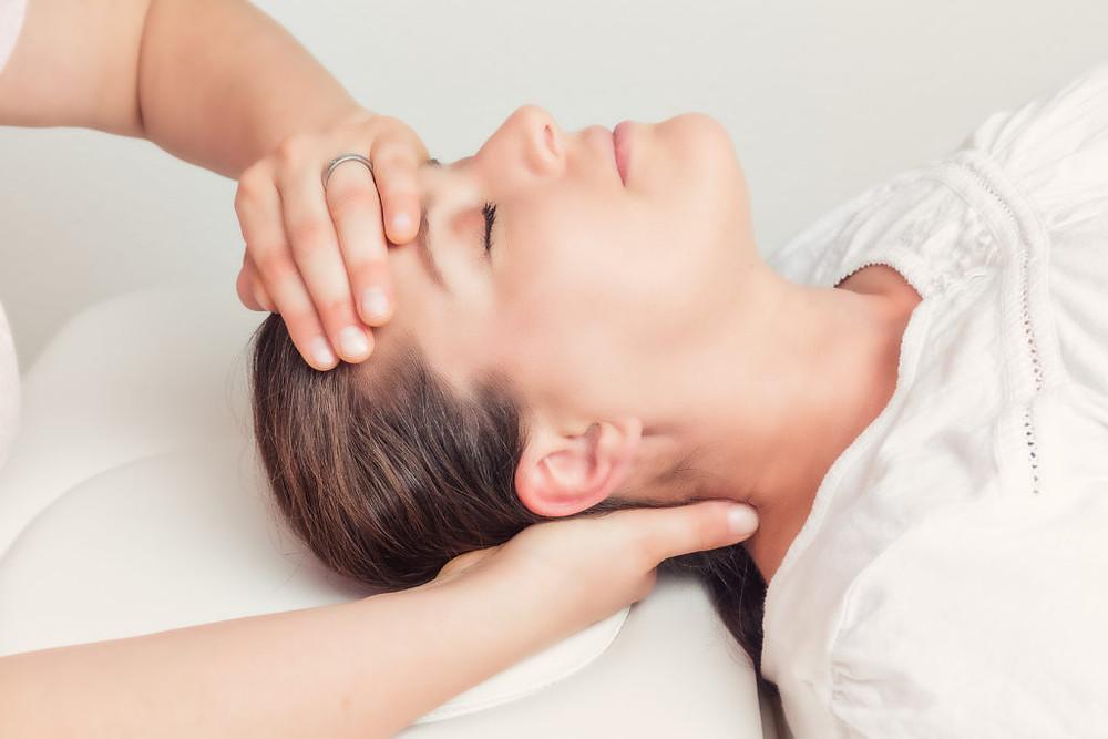 Woman having CST craniosacral treatment