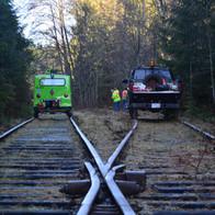 Speeder 16-003 and Hi-Rail 301 at Loon Lake East — MP 21.85