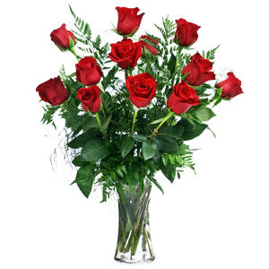 dozen red roses in glass