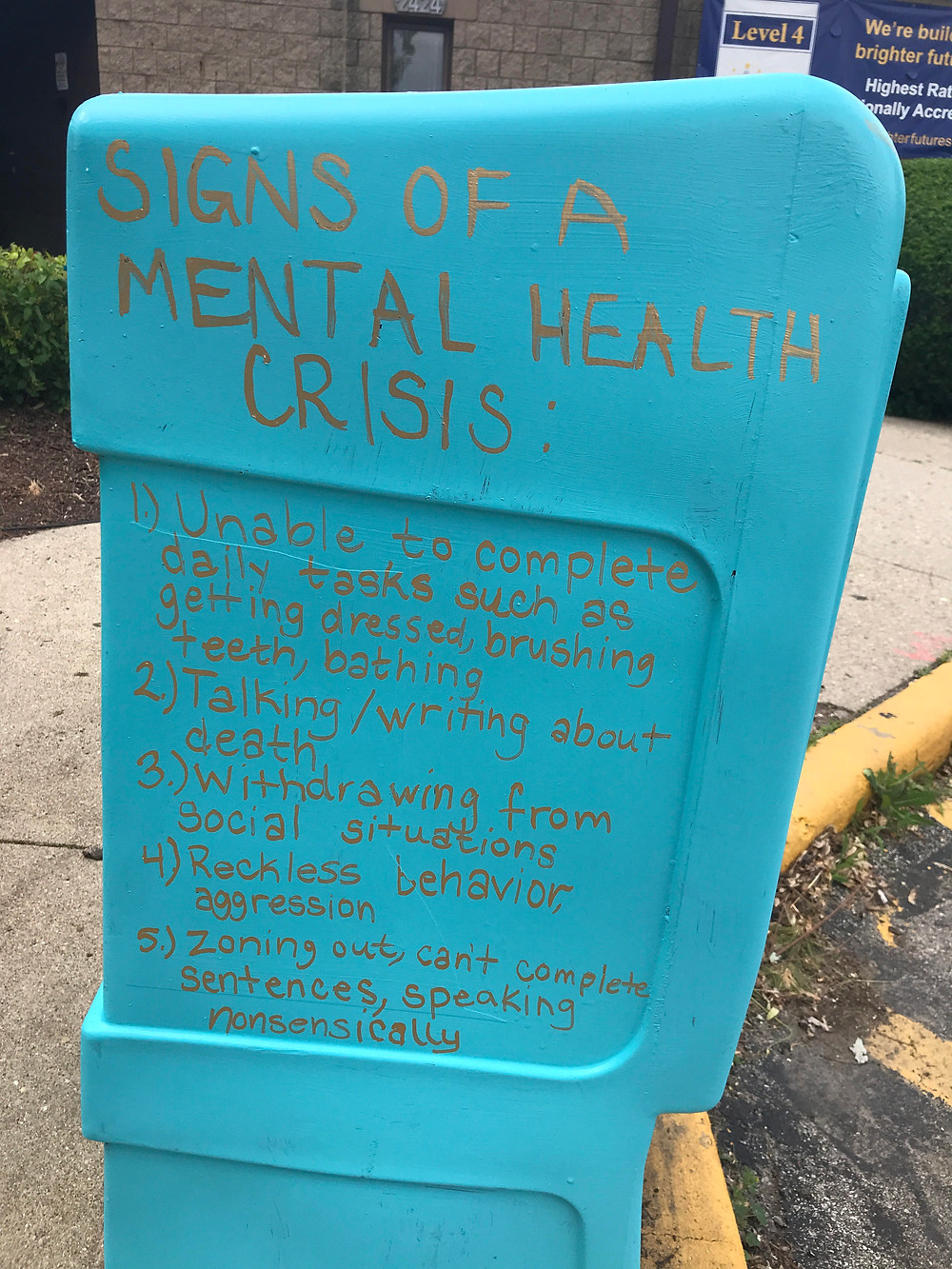 Photo #2 Mental Health Matters Food Box at Flanner House Community Center. Signs of a mental health crisis.