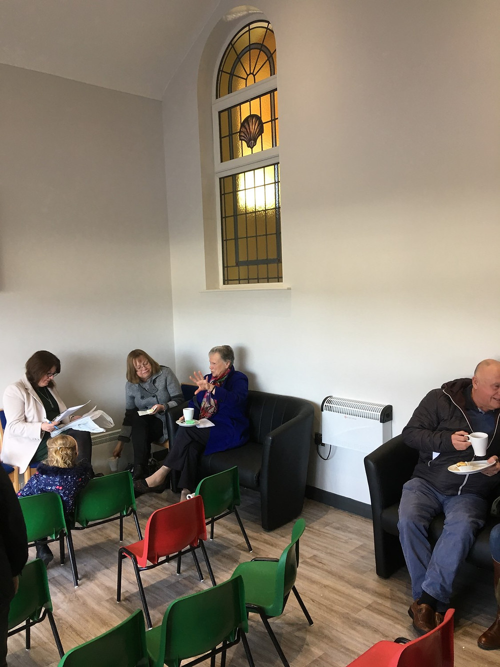 Congregation members using the new space