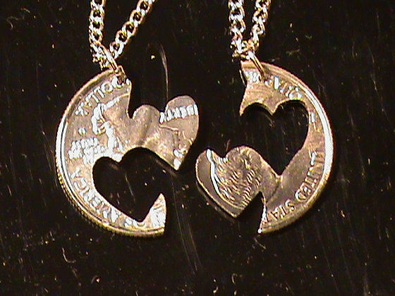 Hand cut interlocking hearts with two chains