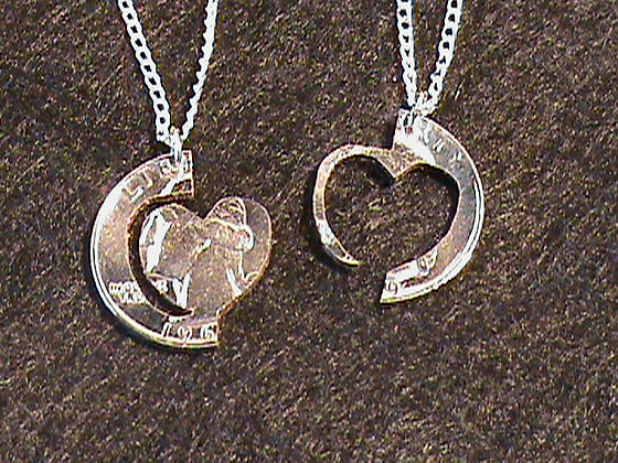 Interlocking hearts with ring hand cut quarter