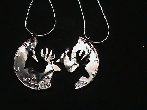 Hand cut Kennedy 50 cent coin used as a Pendant
