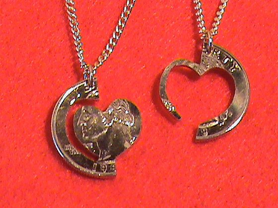 Interlocking hearts 24 kt gold on chains