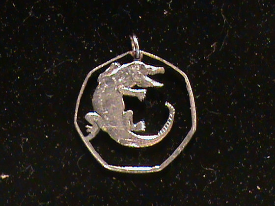Hand Cut African coin with a gator