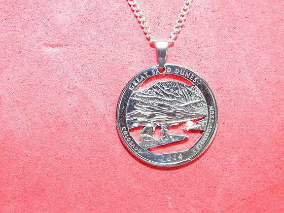 Hand Cut Colorado coin Featuring Great Sand Dunes