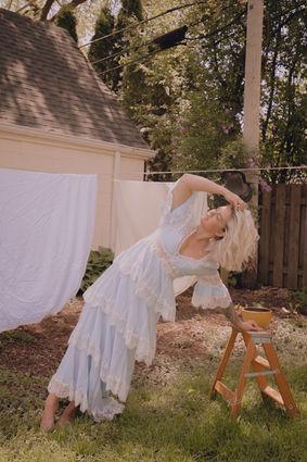 whimsical self portrait with clothesline by arynlei creative