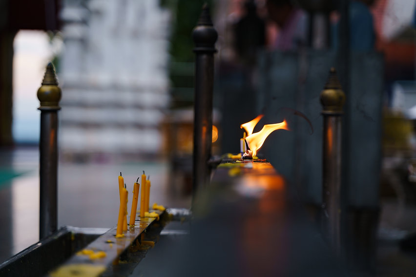 buddhist-tradition-light-candle-praying.