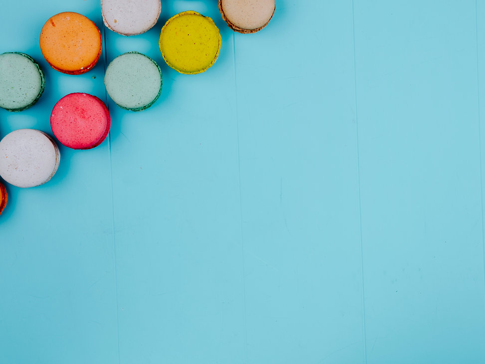 top-view-copy-space-multicolored-macarons-blue-background.jpg