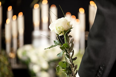 woman-holding-white-flower-funeral.jpg