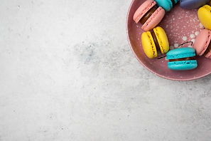 top-view-colorful-pastel-macarons-white-