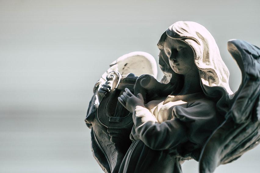 statue-angel-playing-harp-garden.jpg
