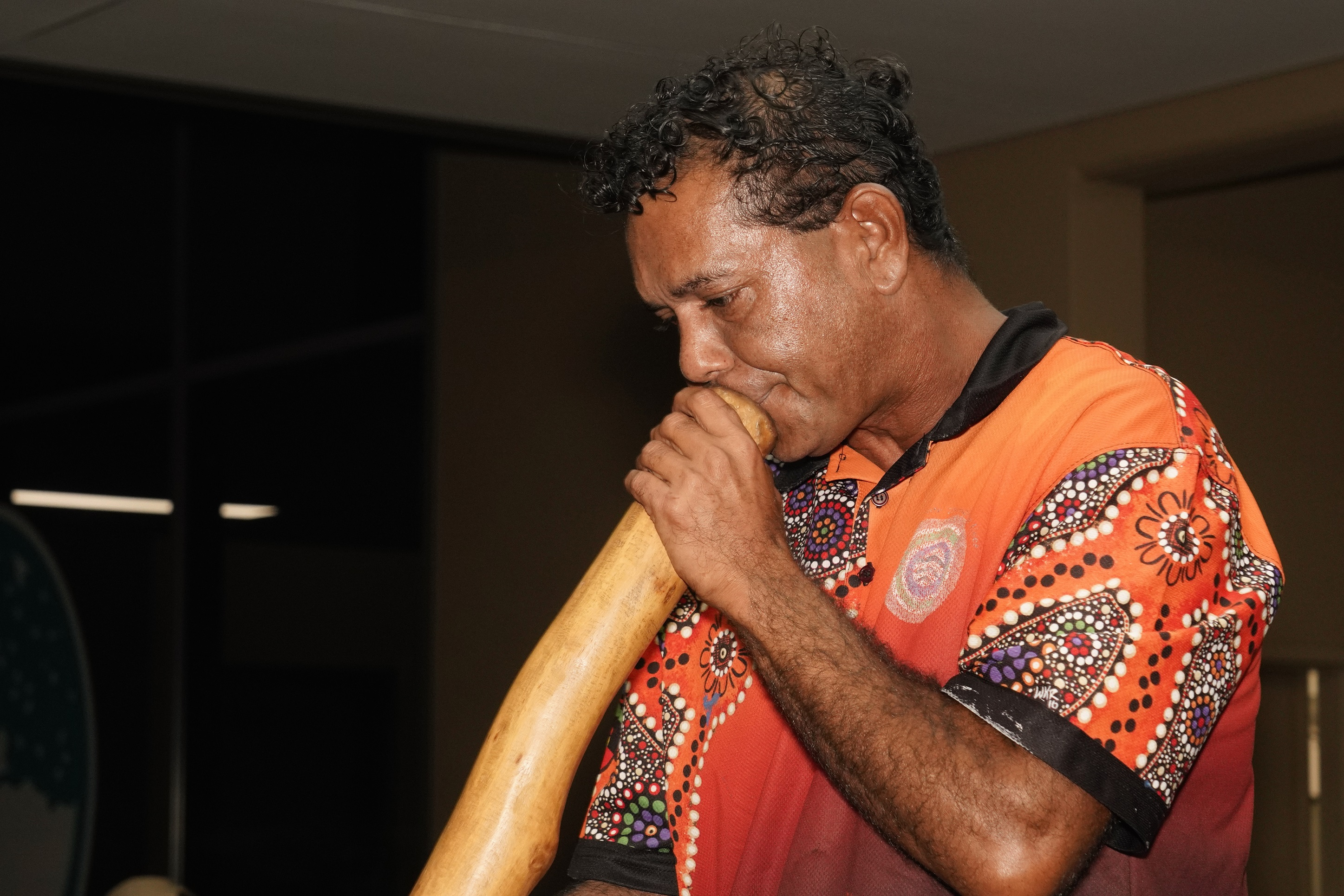 Byron Broome plays didgeridoo during the