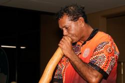 Byron Broome plays didgeridoo during the