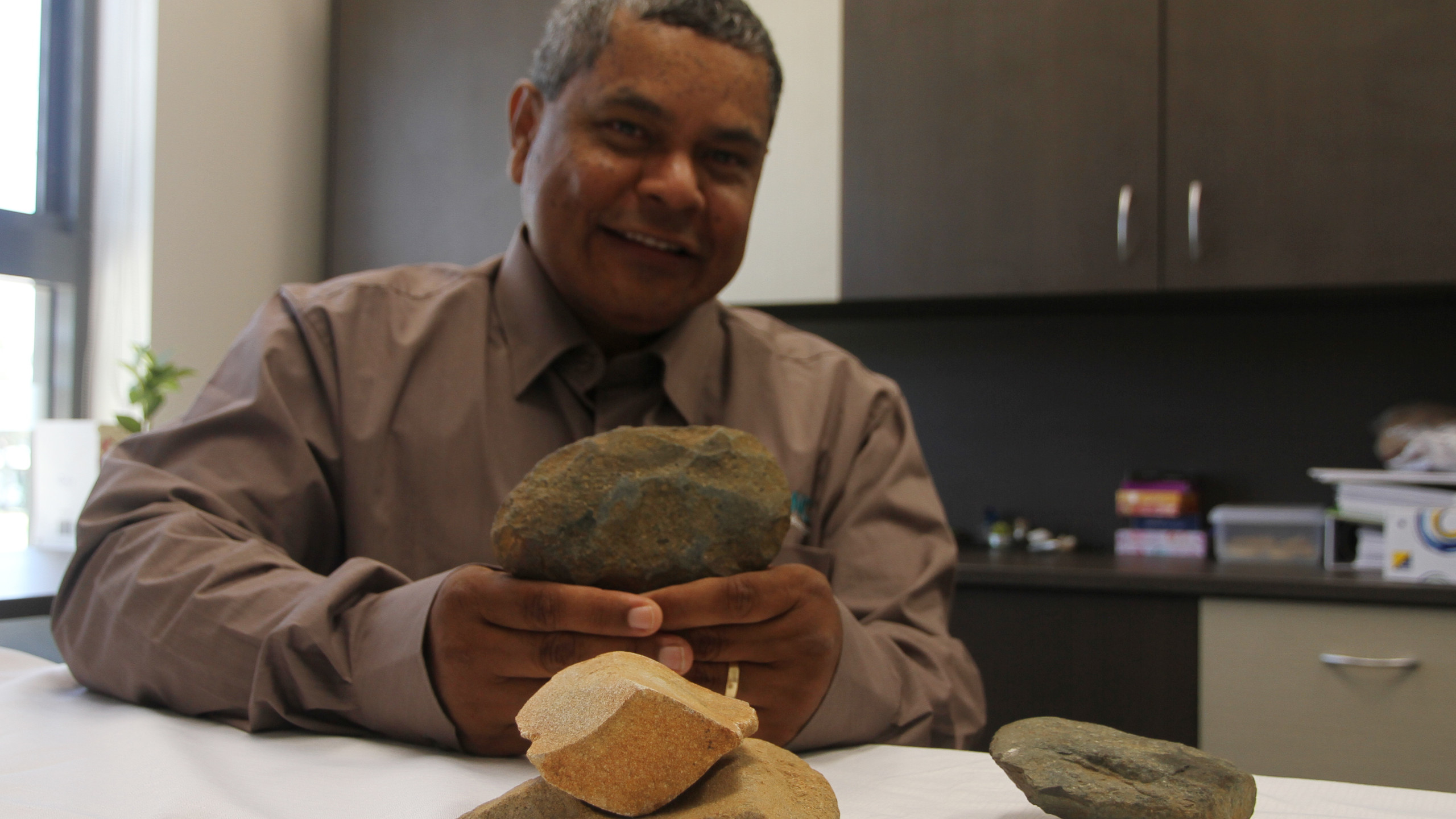 Dale Brown with artefacts