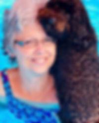 Joan and her chocolate dog Jada in the swimming pool.