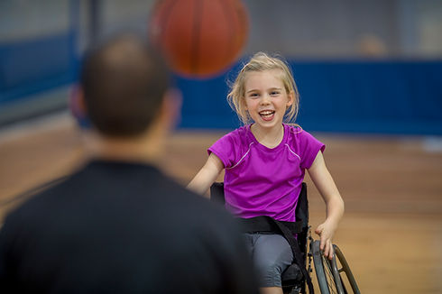 Girl in a wheelchair smiling