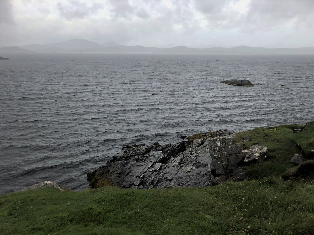 Stormy seas, rain clouds and wind along the NW coast of Bernera in the Outer Hebrides