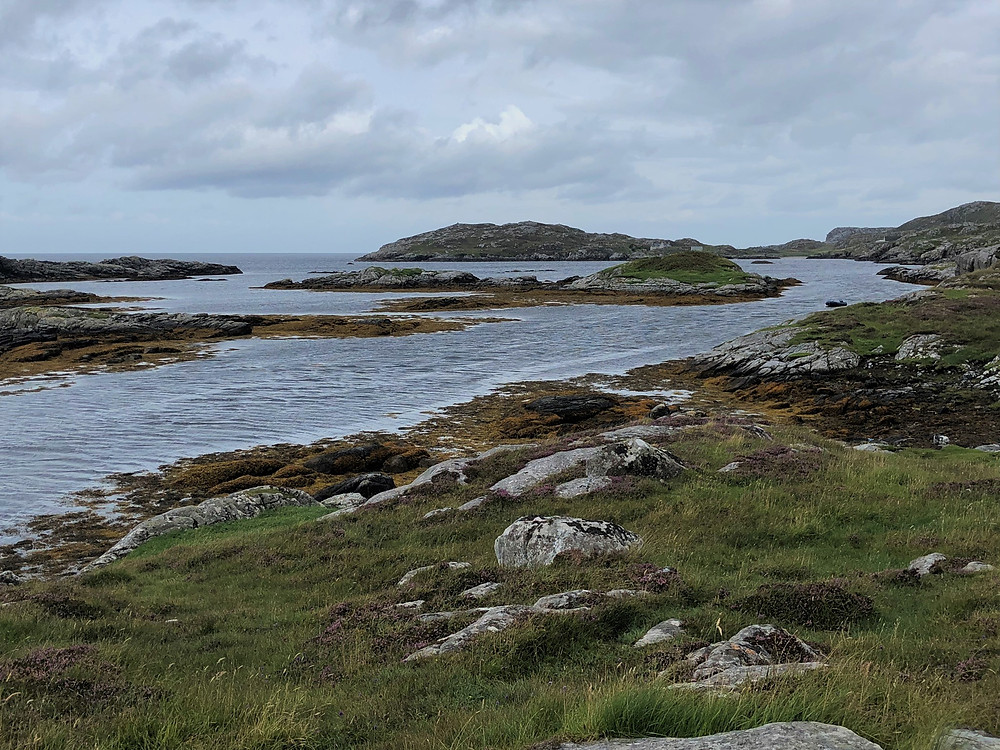 The water of Camas (Gaelic for 'bay') Sanndaig was calm on Great Bernera Loop hike on the NW coast of Isle of Lewis, Outer Hebrides