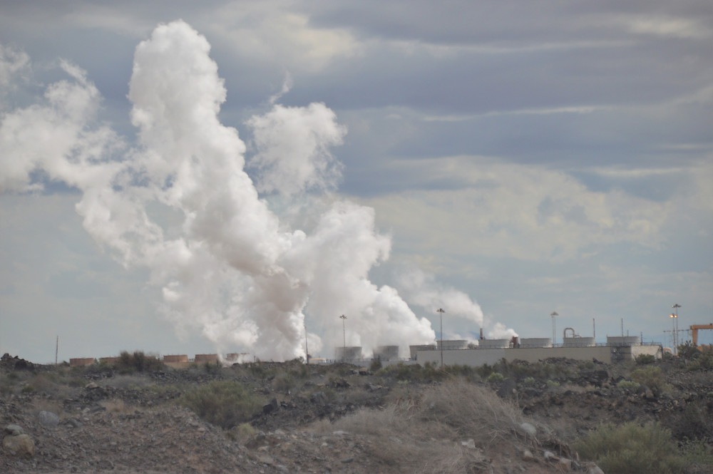 Steam rising from Salton Sea Geothermal plant along Salton Sea