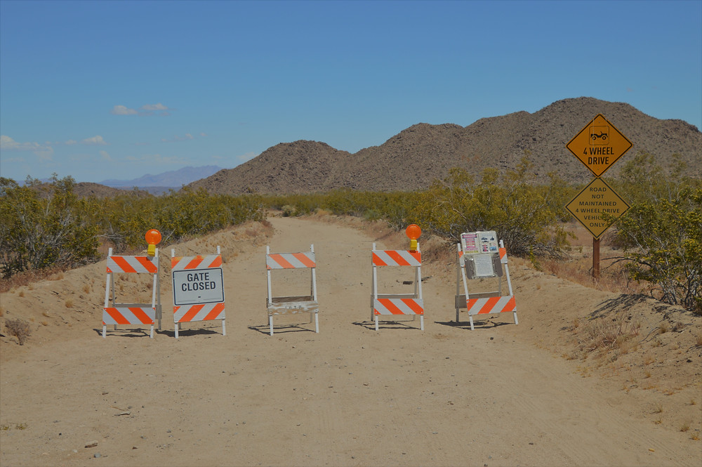 Traffic barriers at entrance to Black Eagle Mine Rd Trail Joshua Tree National Park
