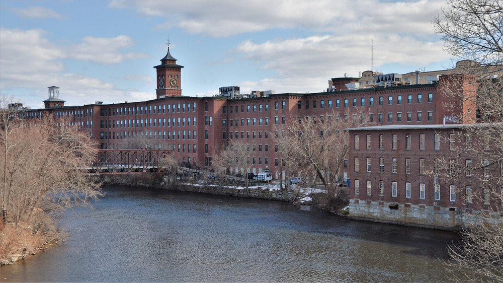 Nashua Manufacturing Co row of mill buildings along the Nashua River