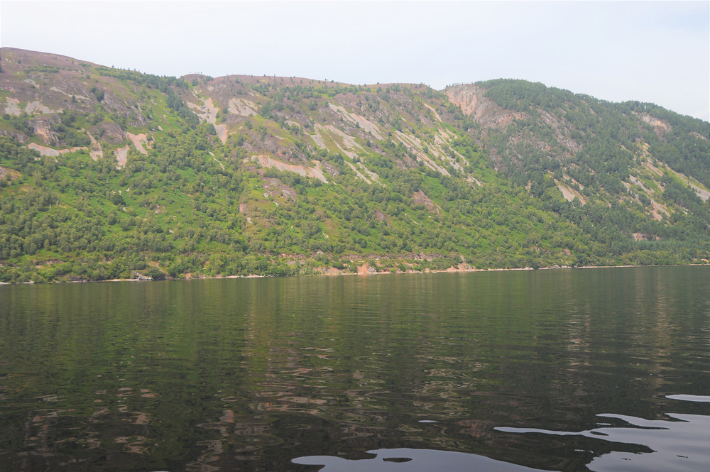 Loch Ness is steep-sided and flat-bottomed