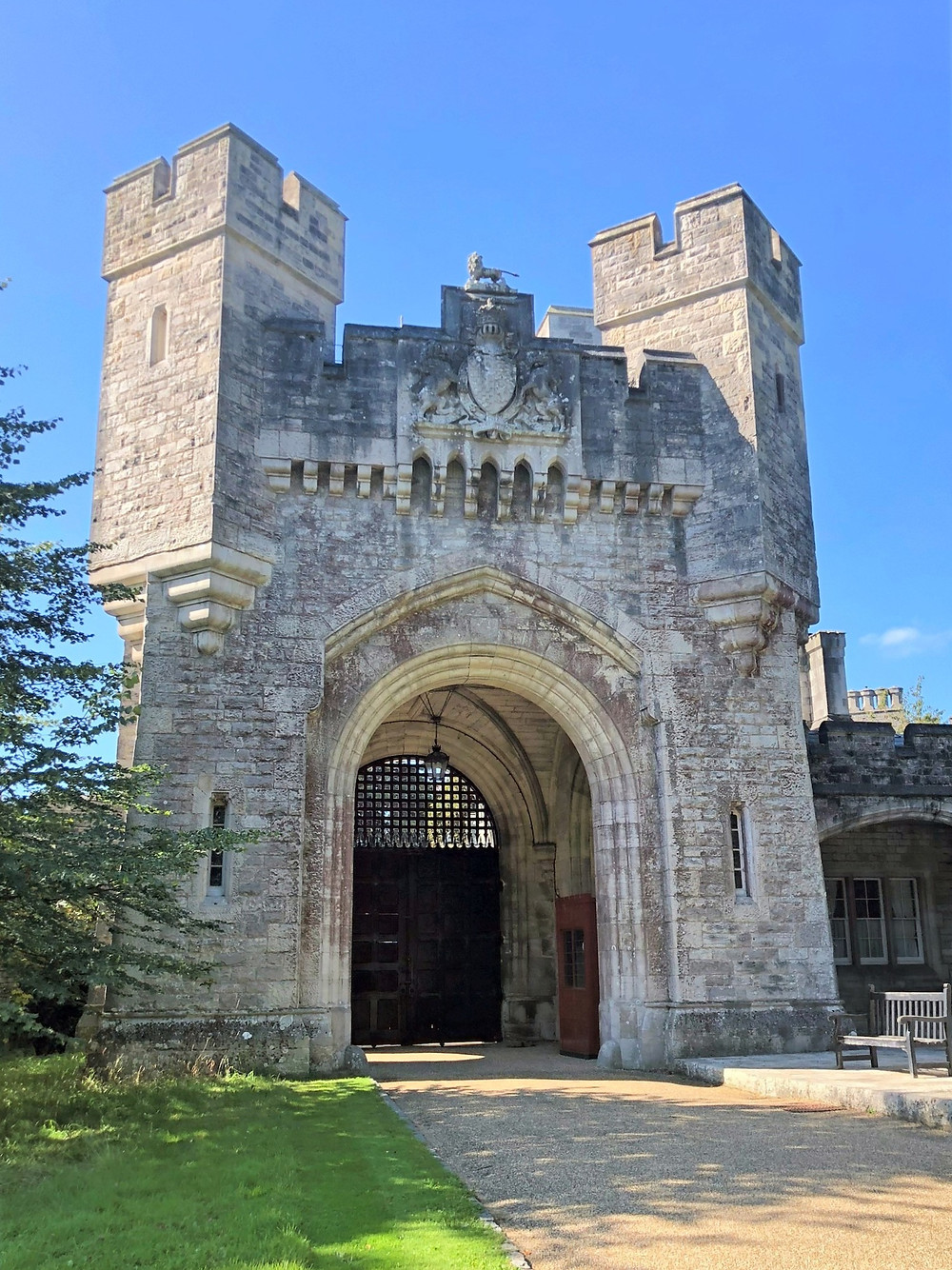 A large stone gate leads to beautiful gardens and the Fitzalan Chapel on Arundel Castle grounds