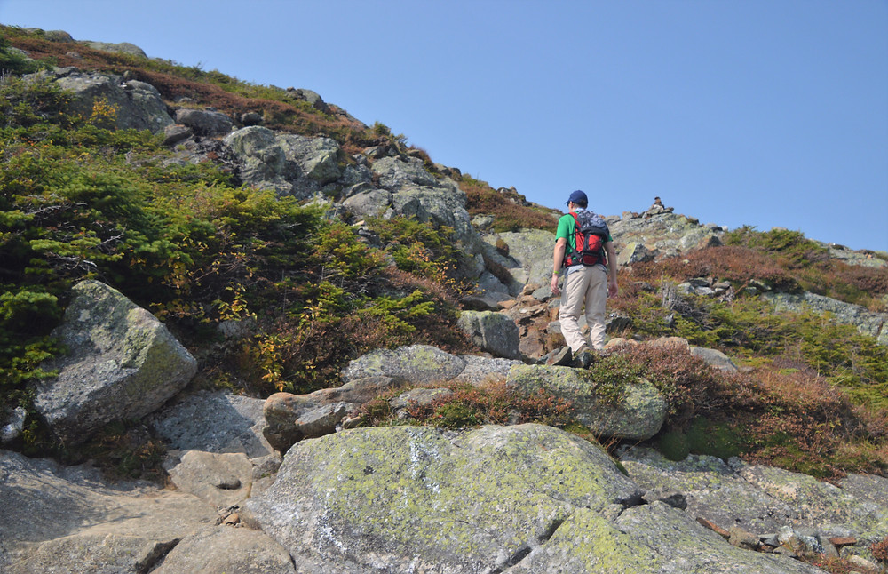 Climbing rocky crag leading to Mt Eisenhower summit