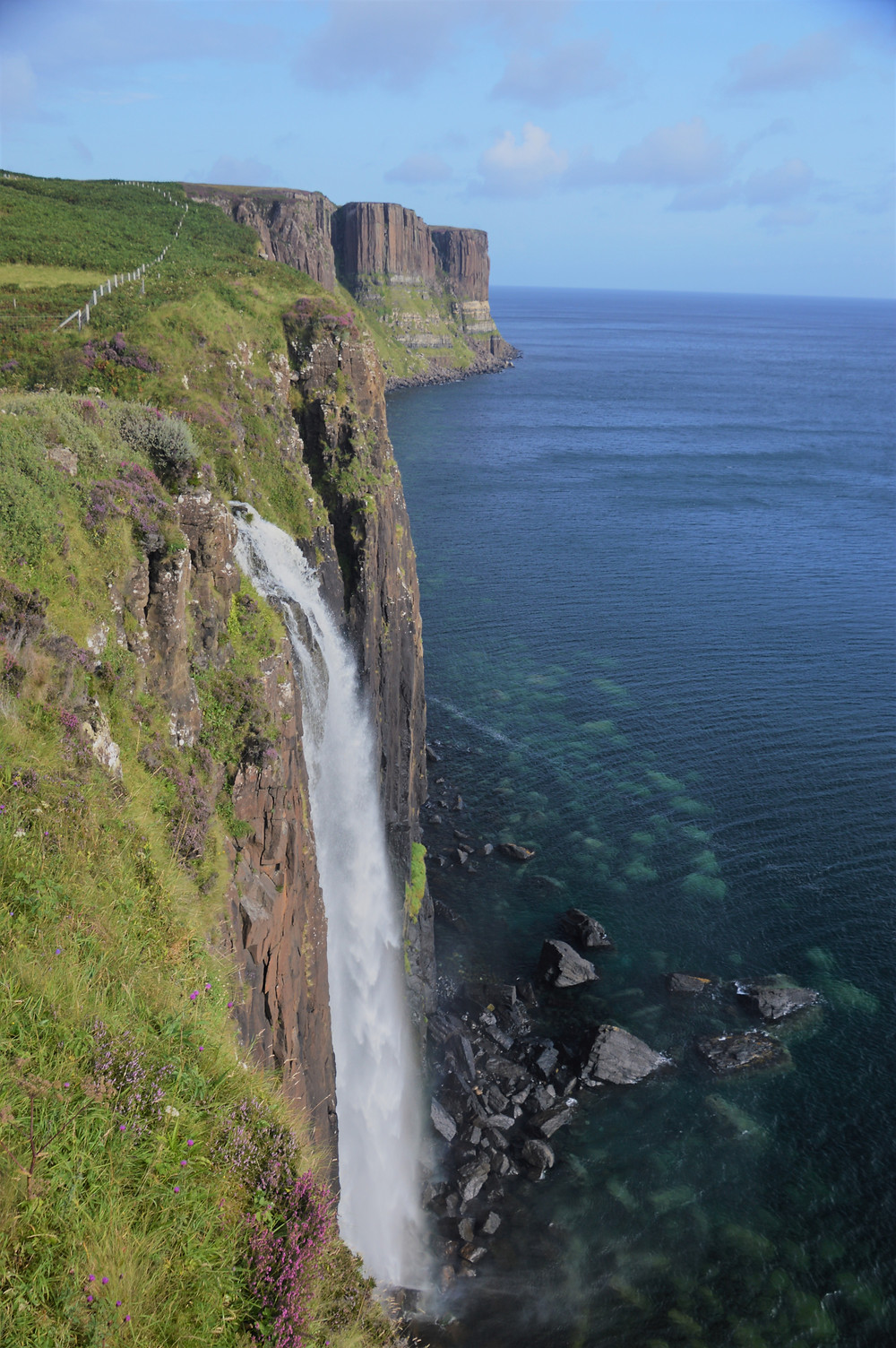 Waters of Mealt Falls plunging over the sea cliffs into the Atlantic Ocean