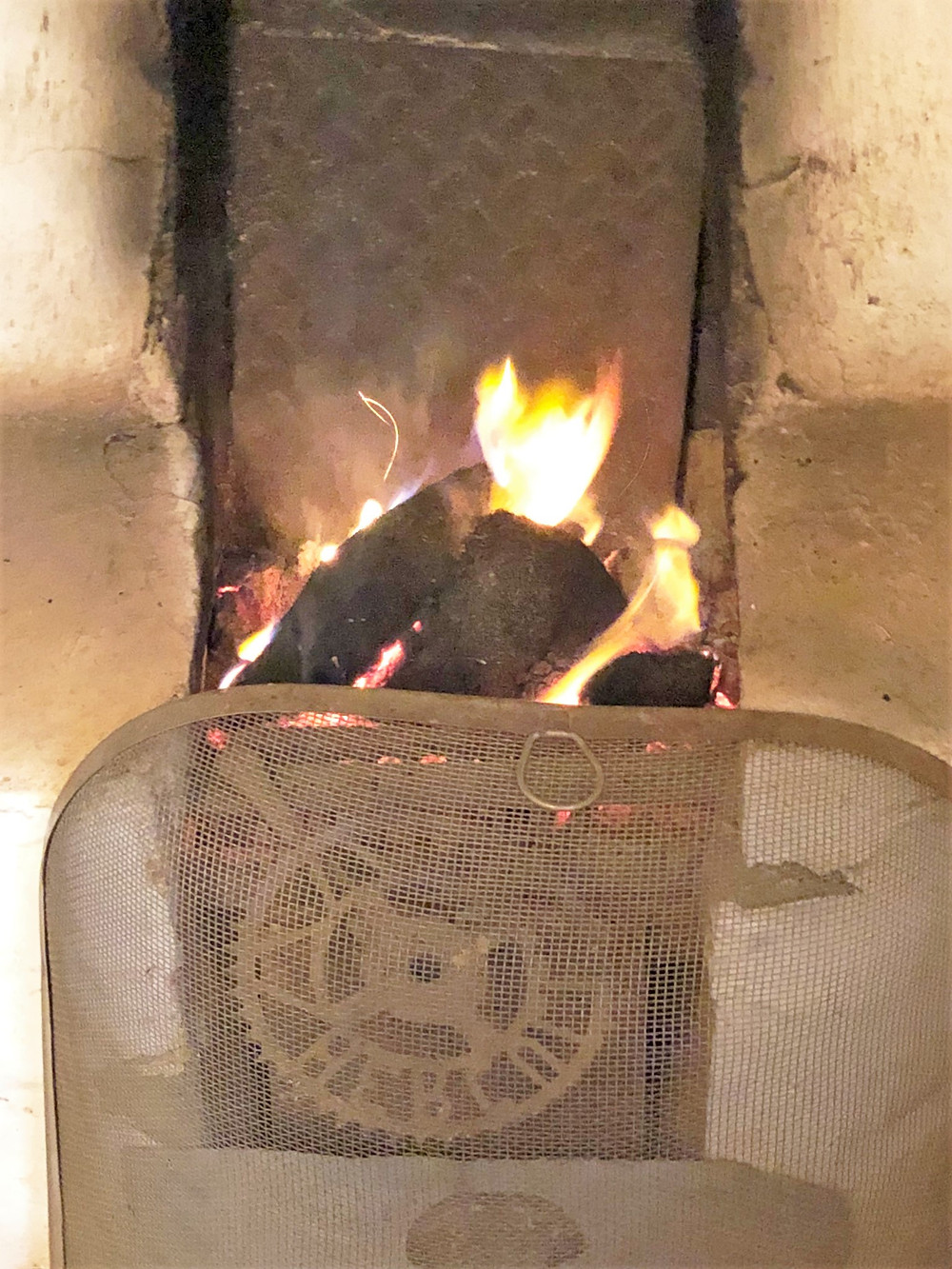 A fire in the small central hearth kept the Gearrannan Blackhouses warm