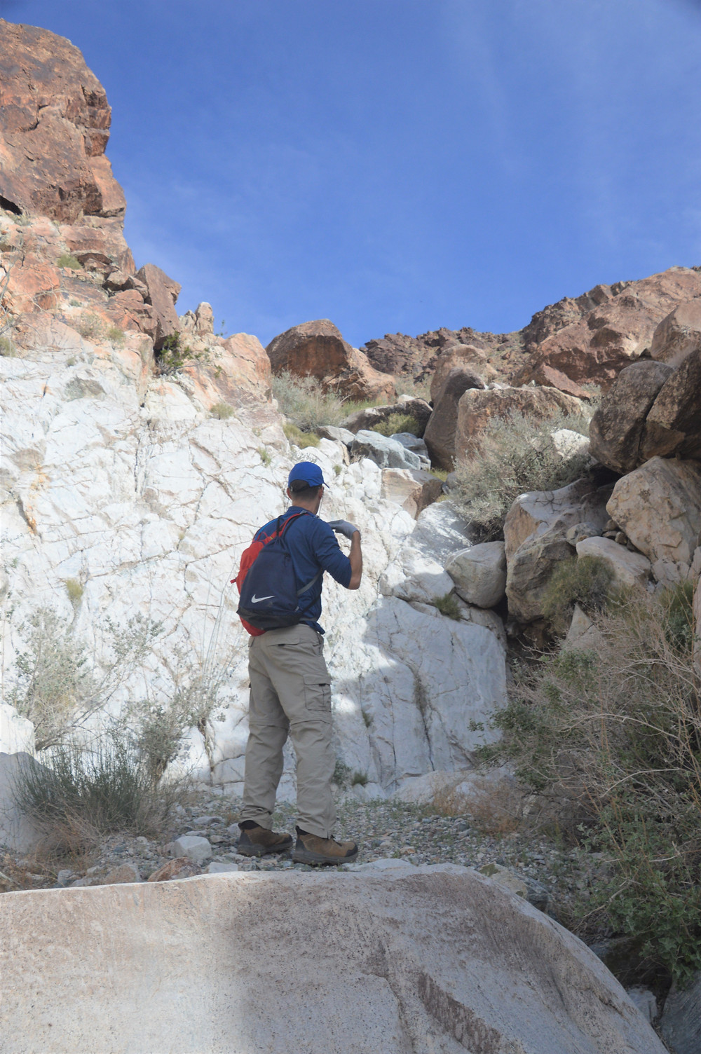Vertical rock wall on hike leading to summit of Pinto Mountain in Joshua Tree National Park