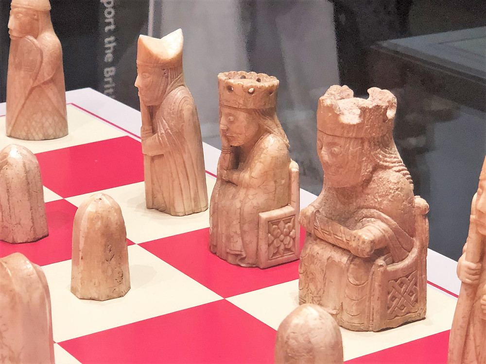 On display in The British Museum the King on throne holding sword; Queen on throne with hand to face; Bishop wearing mitre holding staff and several Pawns from the Lewis Chessmen