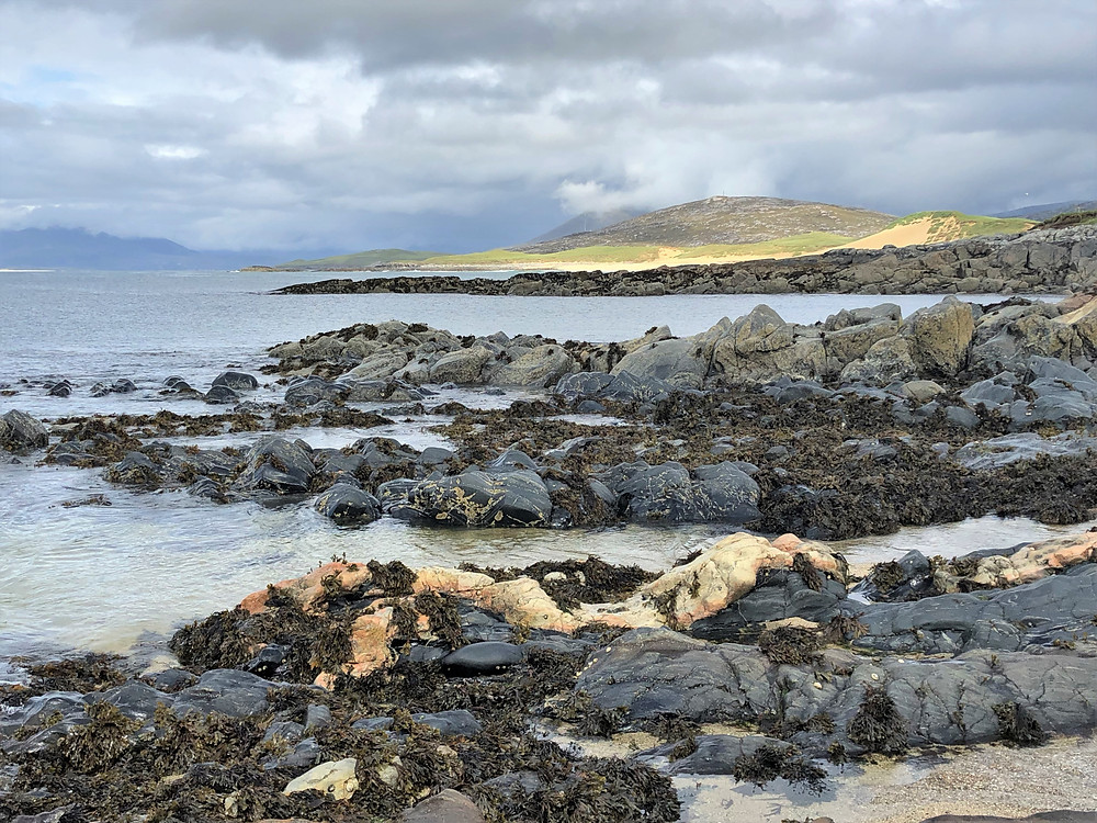 Sheltered rocky beach cove along the Isle of Harris coast in the Outer Hebrides