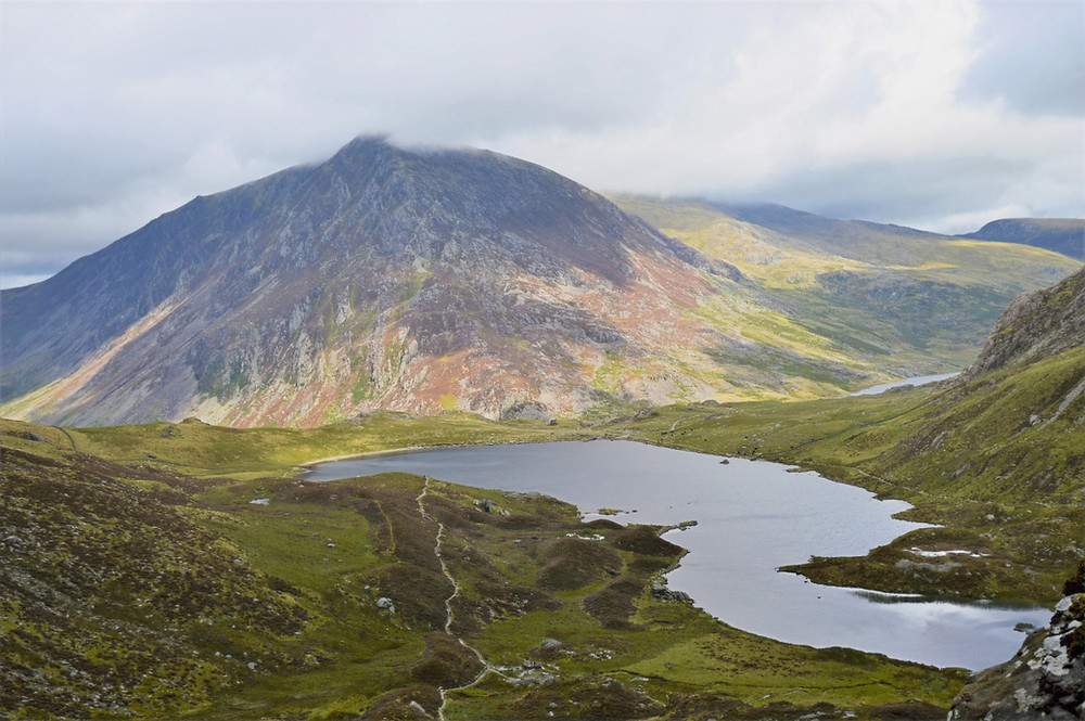 The 3,209 foot summit of Pen yr Ole Wen and across Llyn Idwal viewed from the path leading to devil's Kitchen in Snowdonia.  Pen yr Ole Wen is the seventh highest mountain in Wales.