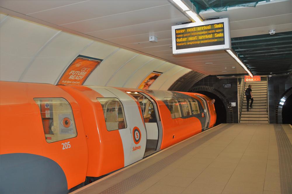 Short orange subway cars in Glasgow