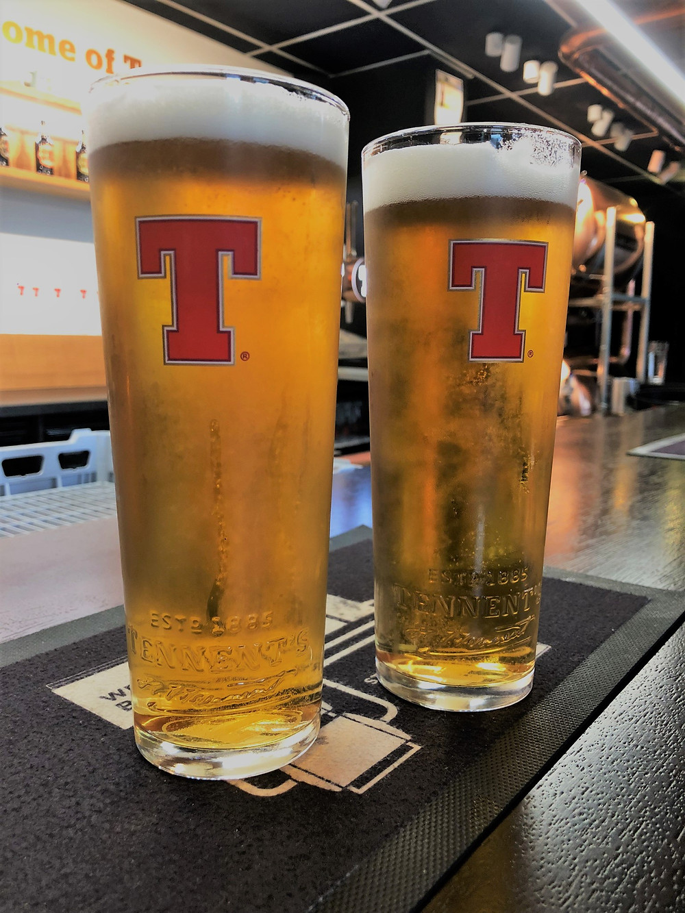 Glasses with Tennent Logo with Tennent Lager at the Tennent Wellpark Brewery in Glasgow