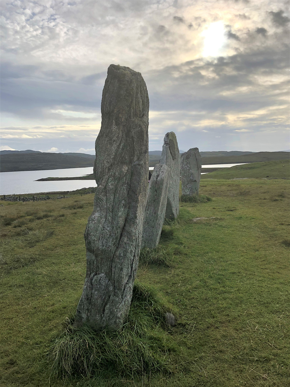 Sun setting over the Standing Stones of Callanish on Lewis and Harris in the Outer Hebrides