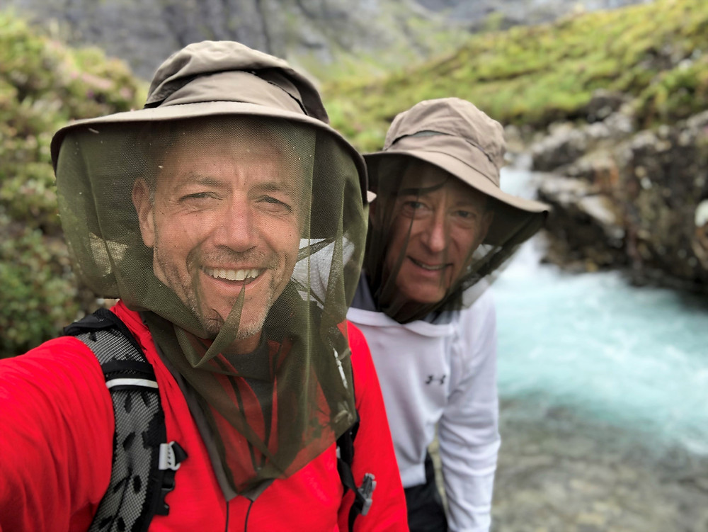 Wearing hats with midge netting at the Fairy Pool on the Isle of Skye