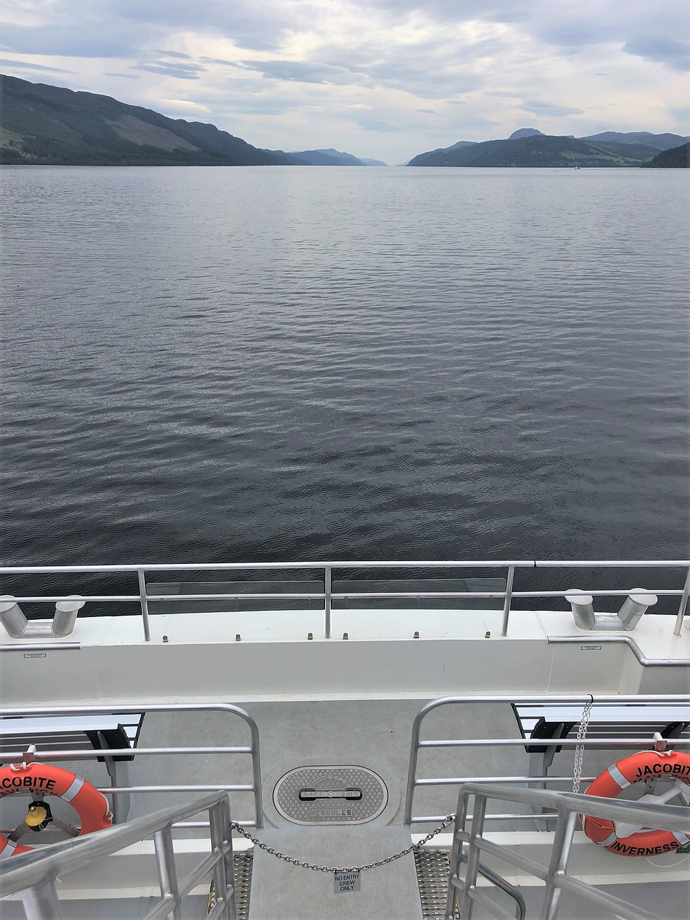 Cloudy day but still water on Loch Ness