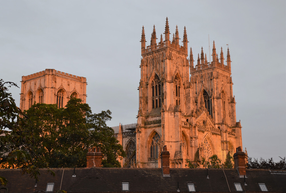 Sunset lighting up the West Towers of York Minster in England