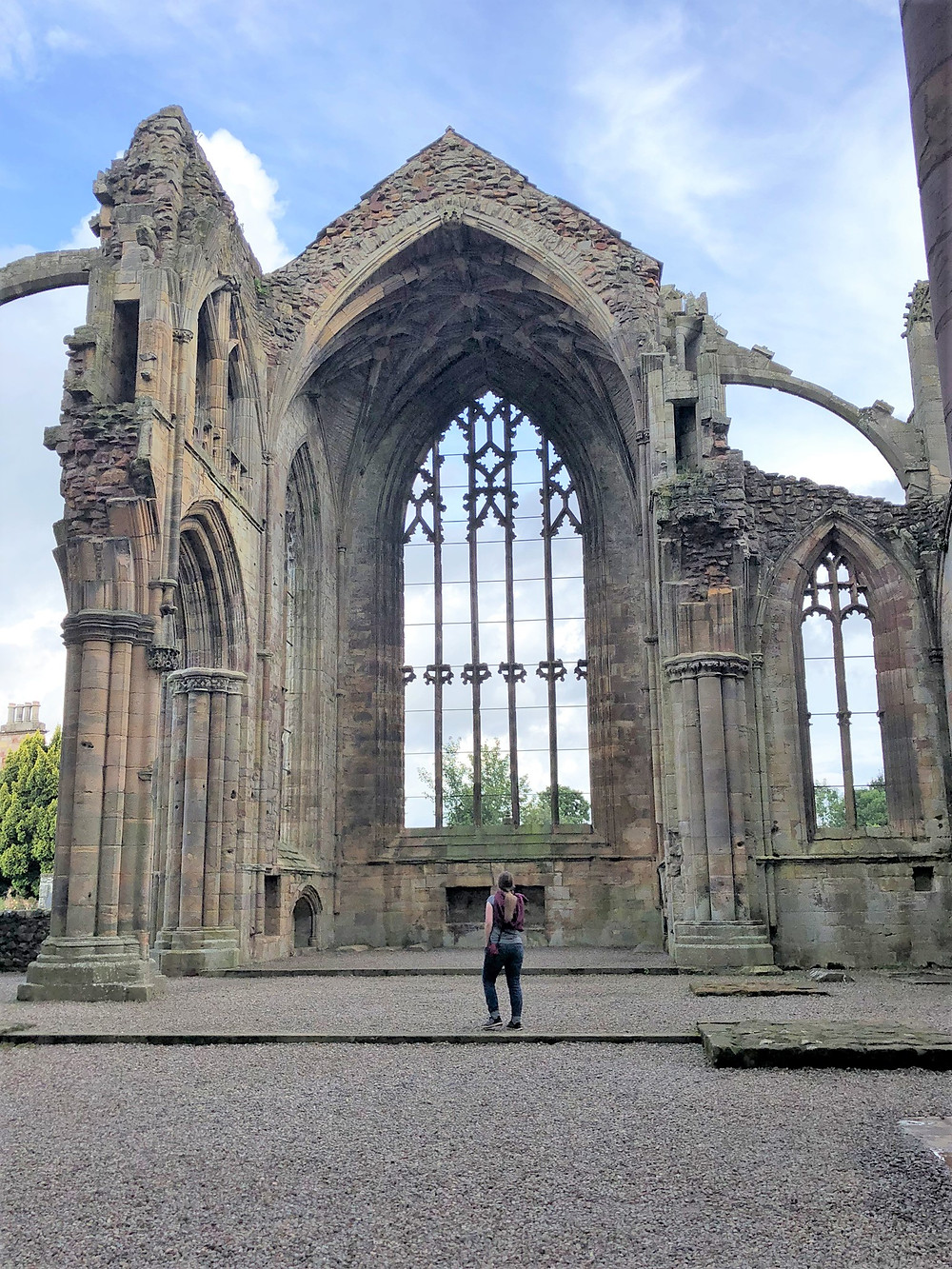 The presbytery at the east end of Melrose Abbey where the high altar once stood. The window tracery is almost completely intact
