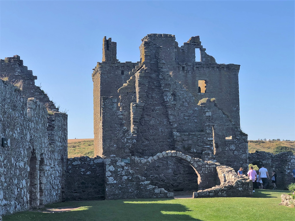 Dunnottar Castle's Tower House or Keep, the prominent 3-story building visible even from a distance, was built in 1392