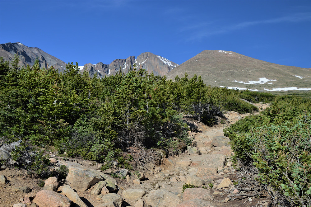 Mountain views of (left to right) Mt. Meeker (13,916 ft), Longs Peak (14,259 ft) and Mt. Lady Washington (13,281 ft) on hike to Chasm Lake in Rocky Mountain National Park