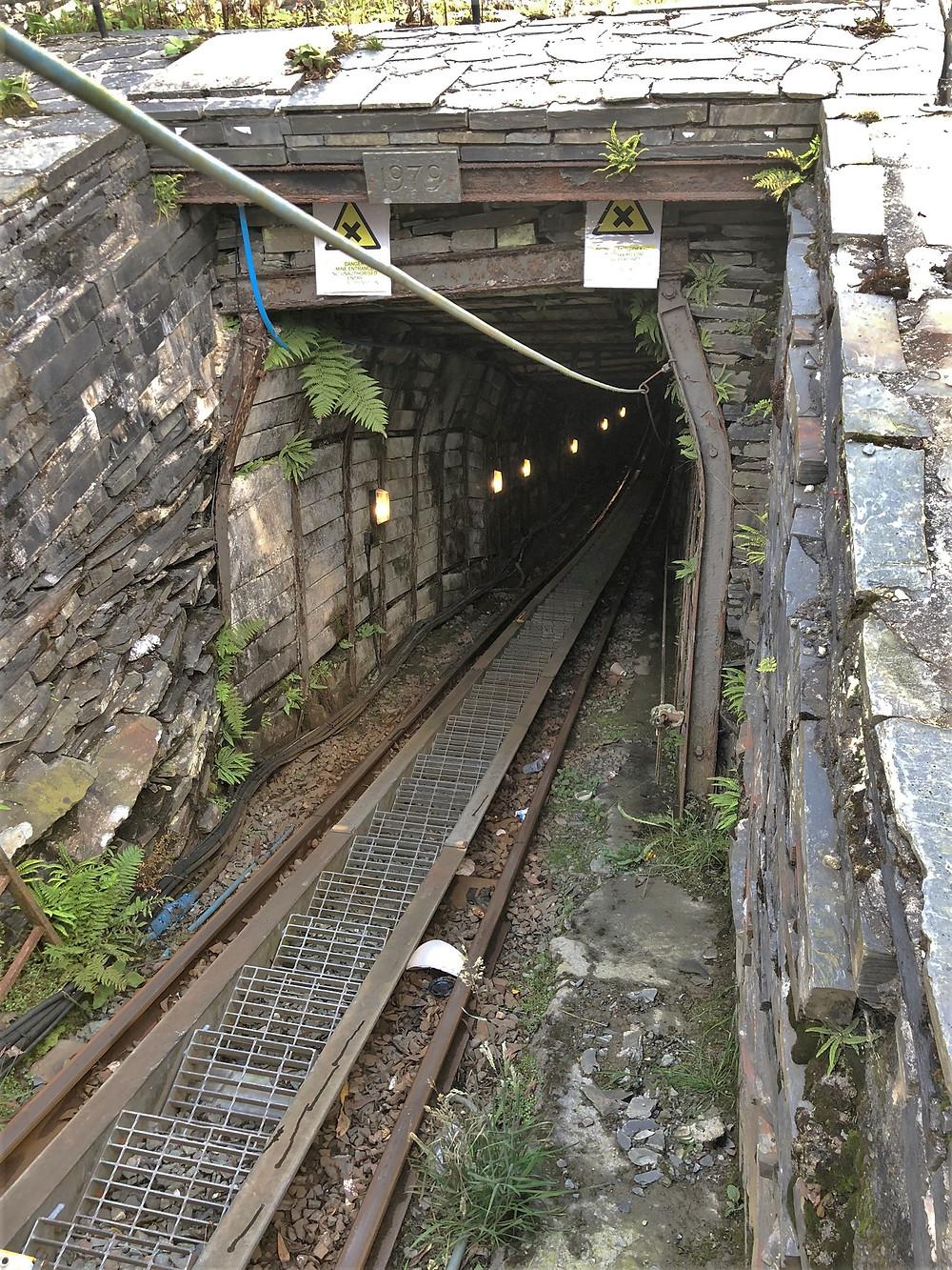 Steep cable railway car descends into Llechwedd Slate Quarry 500 feet below ground