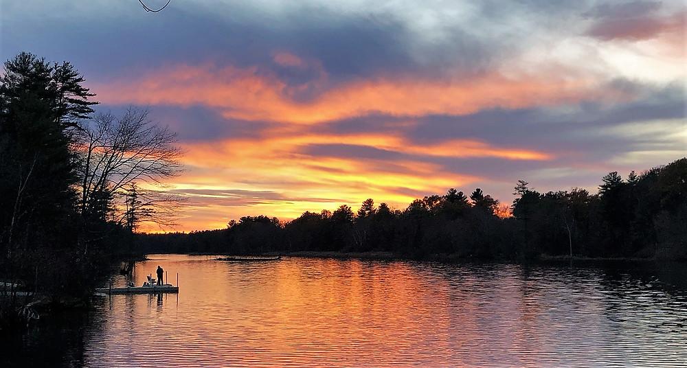 Sunset on Nashua River at Mine Fall dam in Nashua NH
